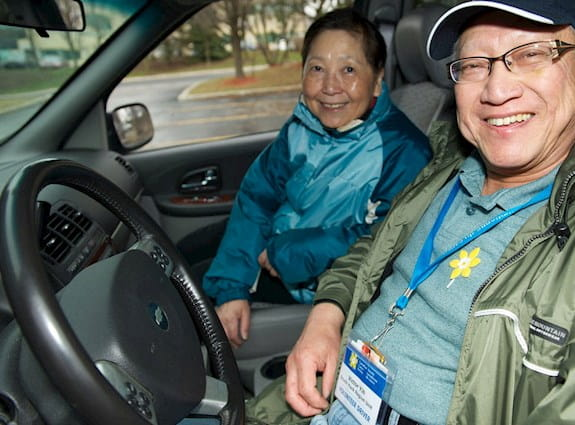 A volunteer driver and his passenger