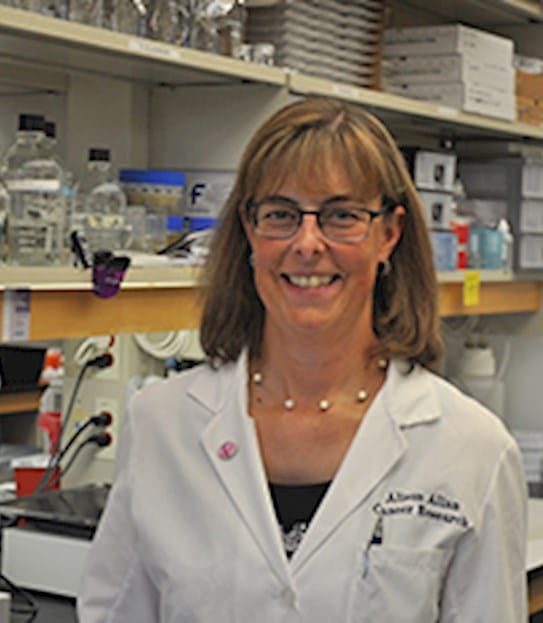 Dr Allison Allan in a lab
