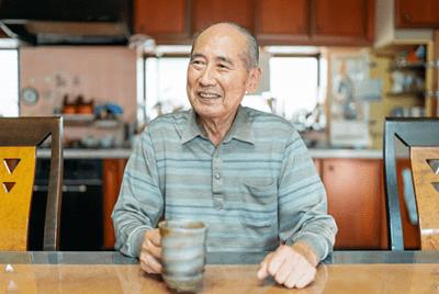 Man sitting at a table holding a mug