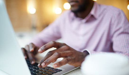 A man on a laptop doing online research