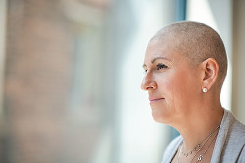 A woman with a shaved head