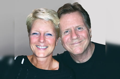 Brian smiling with his wife