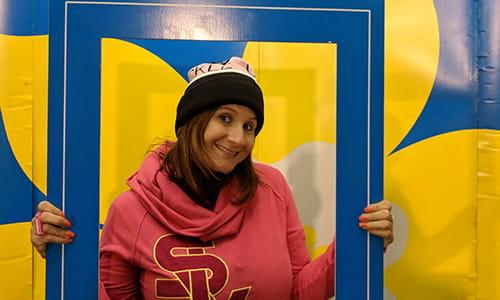 Sarah Midea, Cancer Survivor, holding up a large sized event photo frame