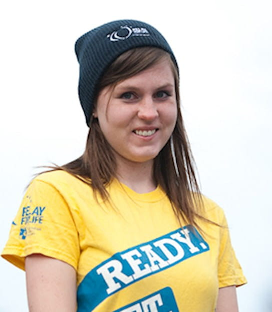A young woman wearing the survivors T-shirt of Relay