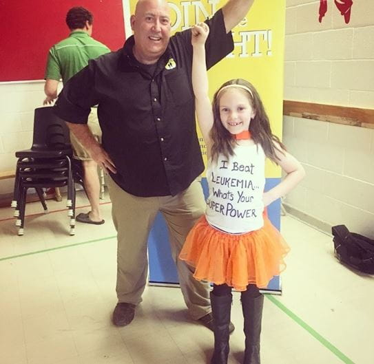 Maci standing next to Police Sergeant John Townsend