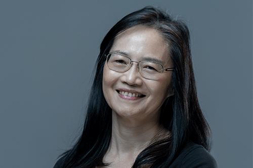 Dr Poh smiling.