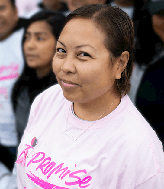 Maja surrounded by a group of people at a past Canadian Cancer Society CIBC Run for the Cure event.
