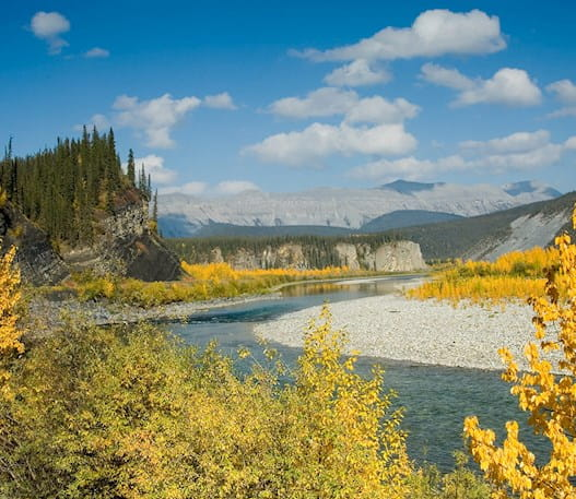 Landscape of the Ogilvie River and mountains in the Yukon