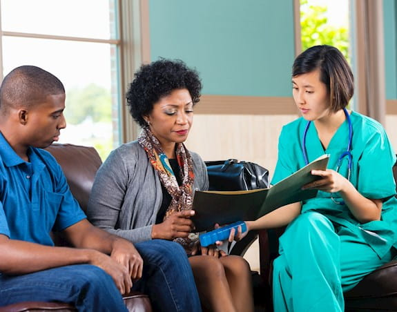 Doctor consulting with patients in a waiting room