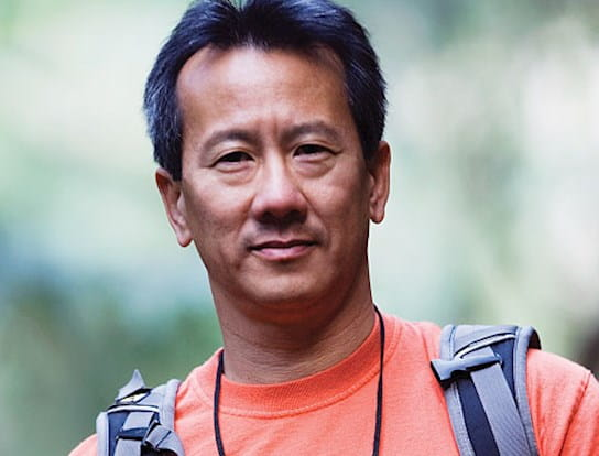 A close up image of a man wearing a backpack
