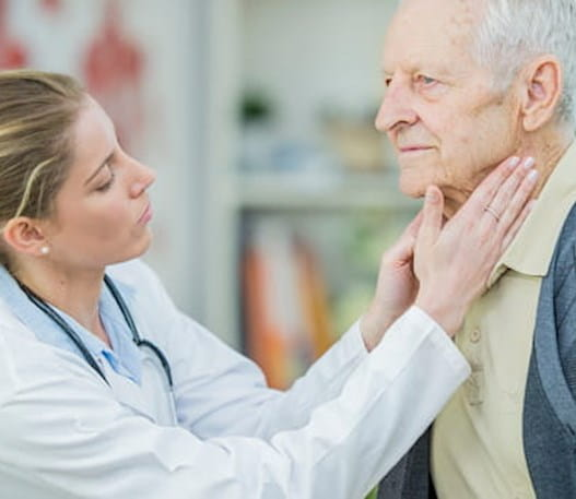 Doctor checking a patients lymph nodes.