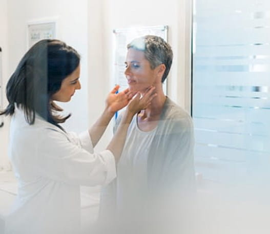 Doctor checking a patients lymph nodes and neck.