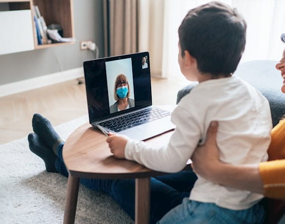 A woman and child on a video call