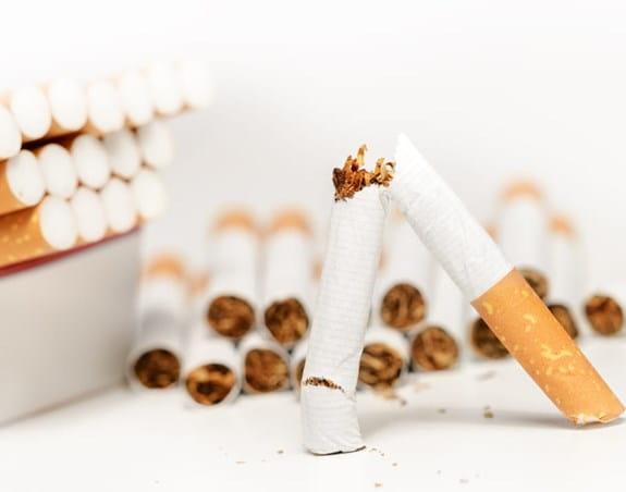 A broken cigarette is being held up