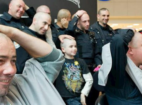 Cops getting their heads shaved.