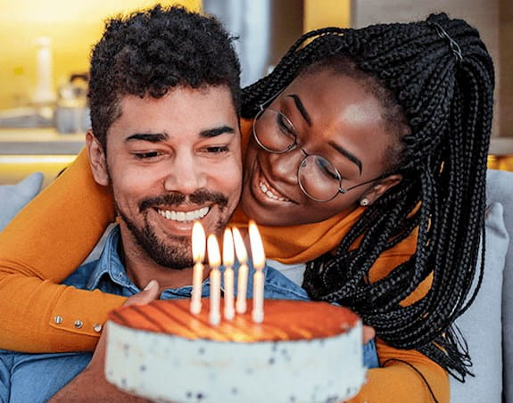 A man and a woman with a birthday cake