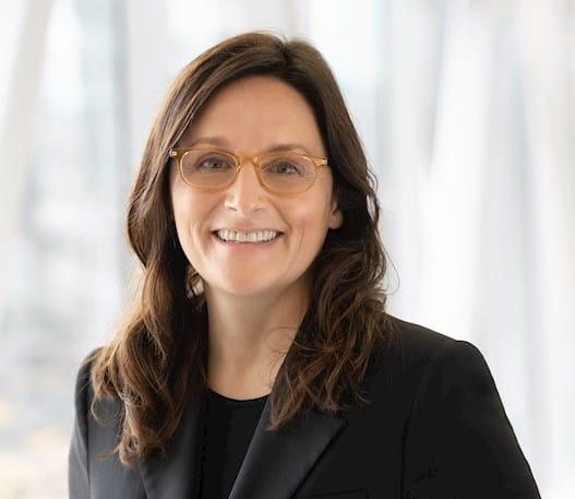 A photo of Dr Cynthia Ménard smiling at the camera