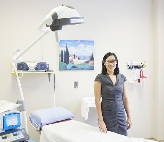A photo of Dr May Lynn Quan smiling at the camera