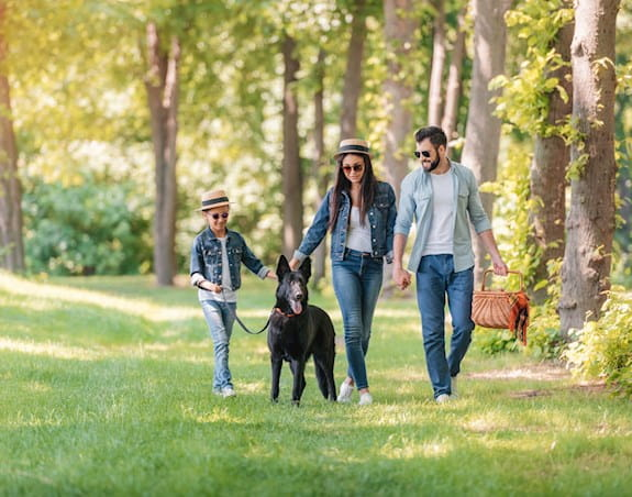 Family with sunglasses and a dog
