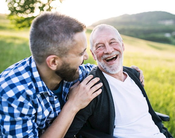 A man and his grandfather share a laugh.