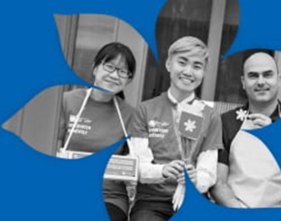 Image montrant trois bénévoles de la Société canadienne du cancer dans un cadre avec des jonquilles.