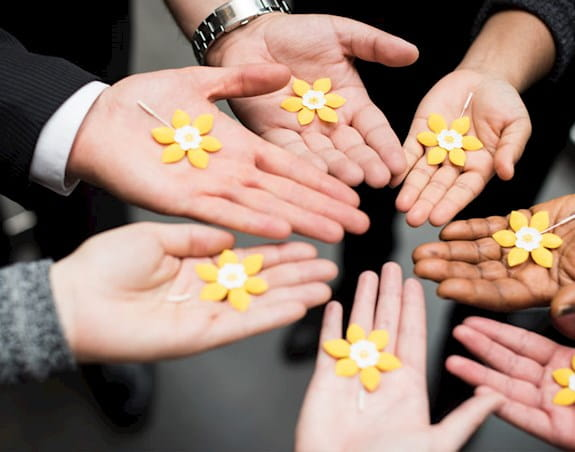 People showing the daffodil pins in their palms