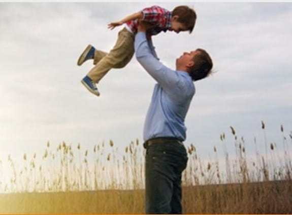 Father holding son up in the air
